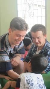 Joe (left) visiting an orphanage in Can Tho.