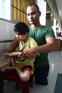 Nguyen Hong Loi and child born without eyes in Agent Orange children's ward at Tu Du Hospital in Ho Chi Minh City, Vietnam